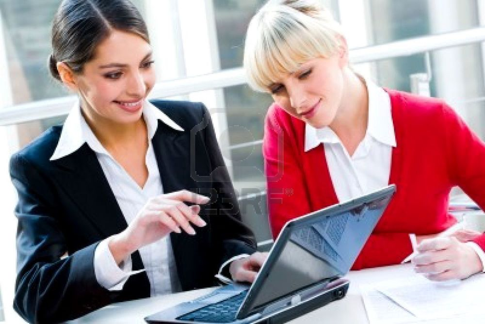 2513177-portrait-of-two-successful-business-women-working-together.jpg