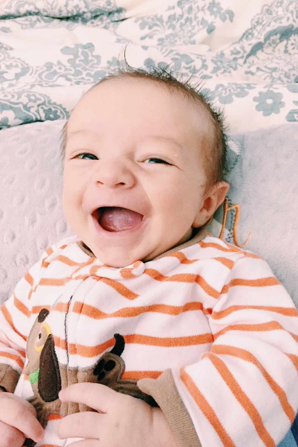 First social smiles at 7 weeks, oh what we now will do to evoke these grins!