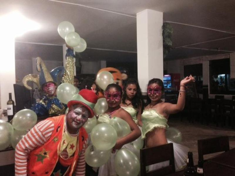 Balloons, clowns, scantily clad dancing girls. It must be party time