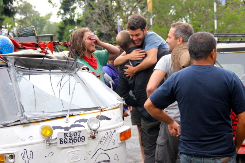 Teams celebrate finishing the April 2013 Rickshaw Run in Shillong