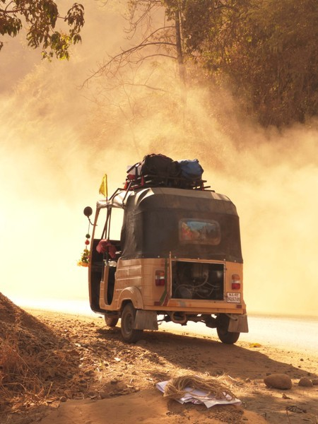 When entering a dust storm be thankful that a three wheeled rickshaw with no doors is a perfect vehicle to protect you from the elements.
