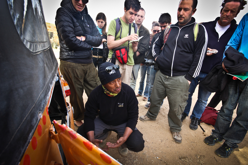 Teams on the Rickshaw Run January 2013 learning about the innards of the three wheeled beasts