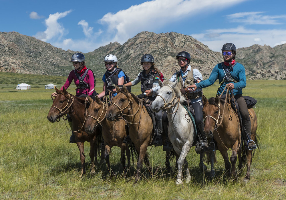 Left to right: Shelley Bates, Hannah Bronwin, Barbara Seele, Inge Rall-Behm, and Todd Cranney cross the line of the Mongol Derby together, 13th Aug 2013