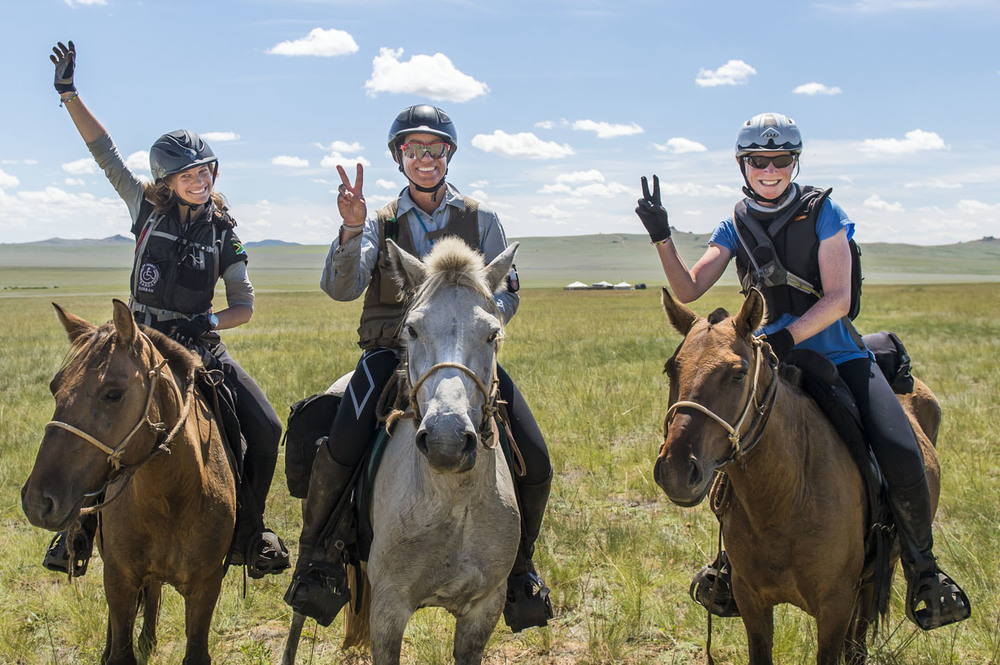 Barbara Seele, Inge Rall-Behm and Heather Bronwincelebrate finishing the Mongol Derby, 13th Aug 2013