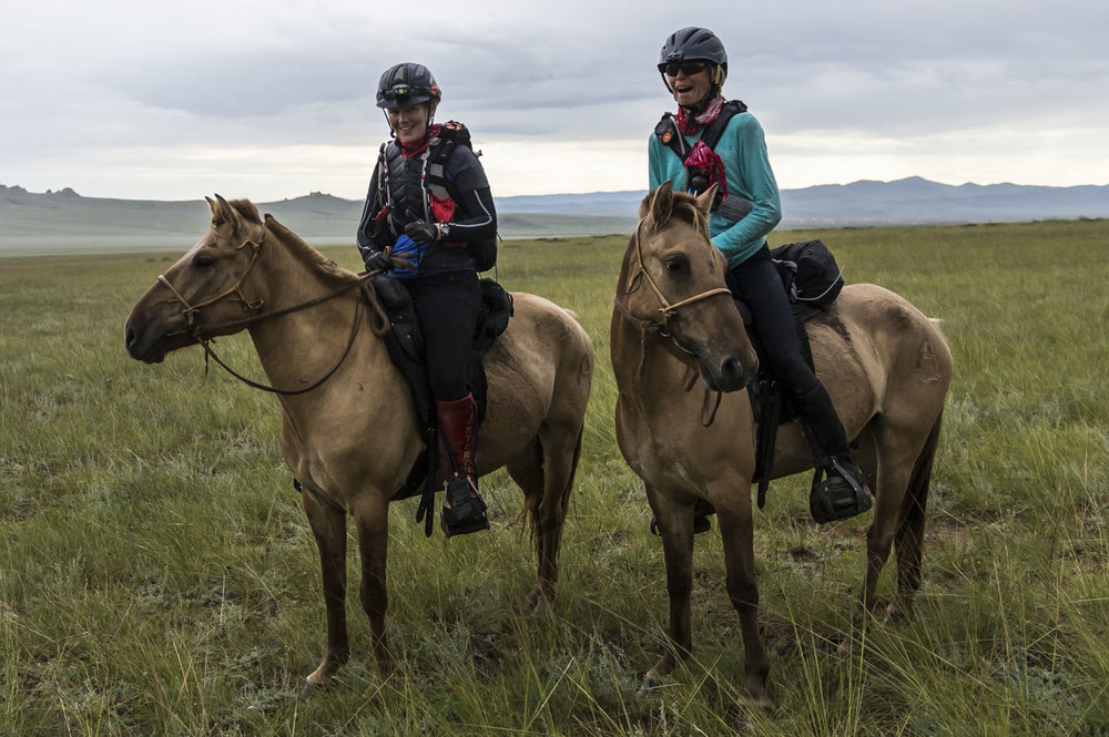 Sandra Fretelliere and Lynne Gilbert are all smiles on finishing the Mongol Derby in wet conditions, 12th Aug 2013