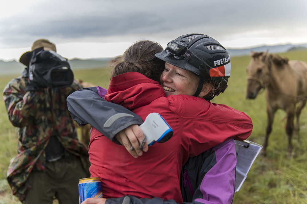 Sandra Fretelliere receives a congratulatory hug from Catriona Paterson on finishing the Mongol Derby 12th Aug 2013