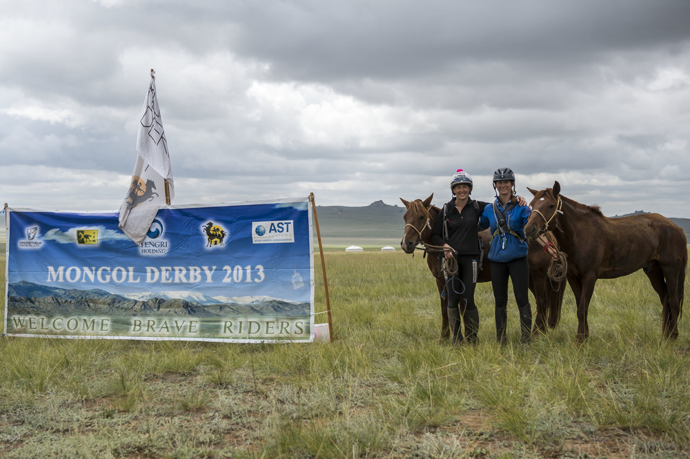 Clare Twemlow and Kirsten Melis at the finishing line of the Mongol Derby, 11th Aug 2013.
