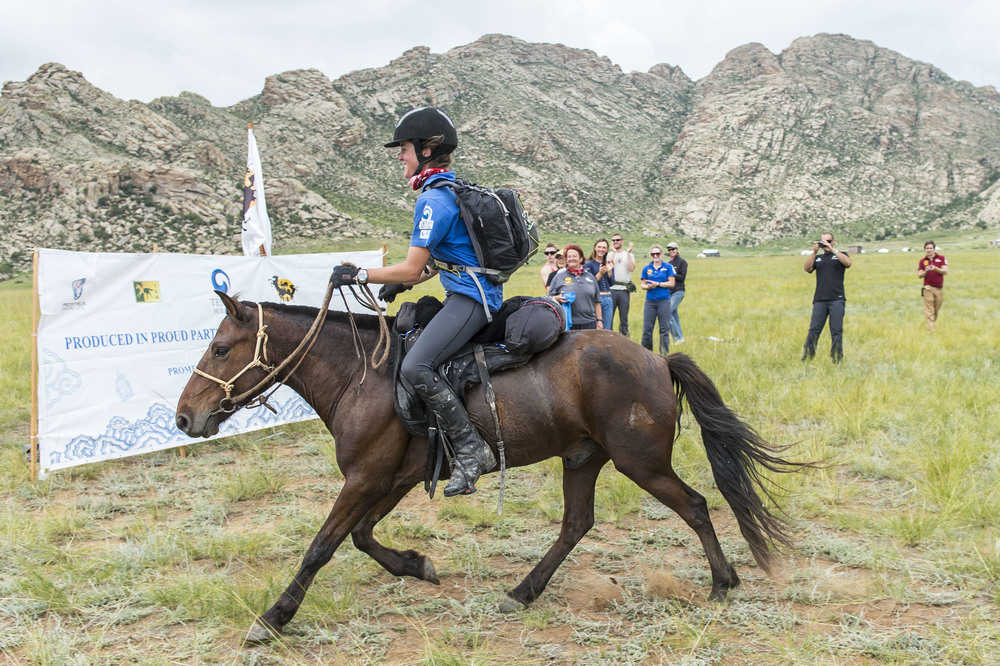 Chloe Phillips-Harris crosses the line of the Mongol Derby, 11th Aug 2013