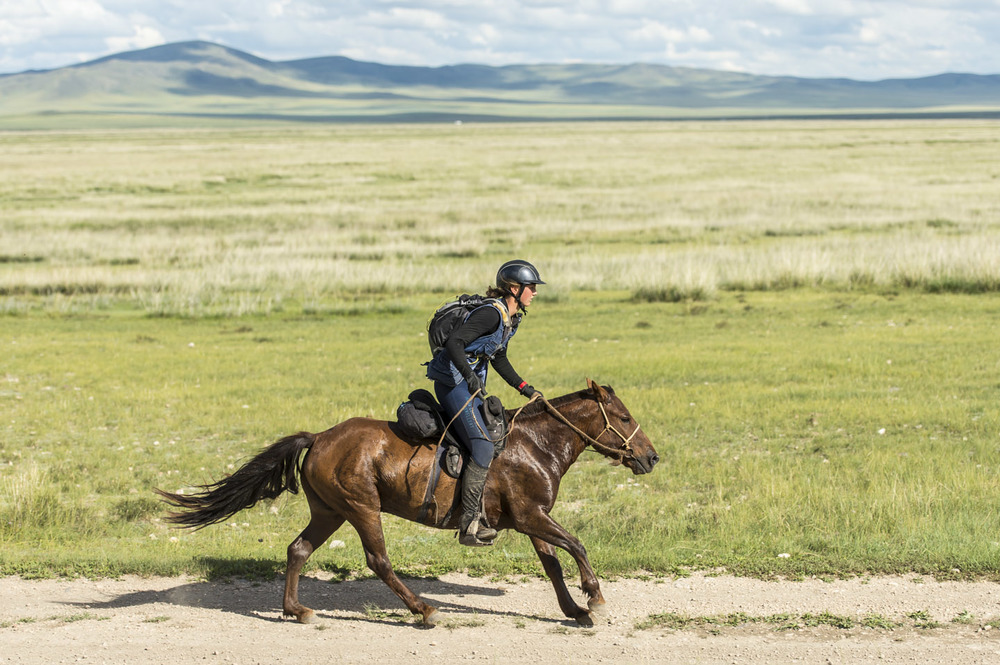 Lara Prior-Palmer chasing Devan Horn on the last leg of the Mongol Derby, 10th Aug 2013. She started the leg around 10 minutes behind.