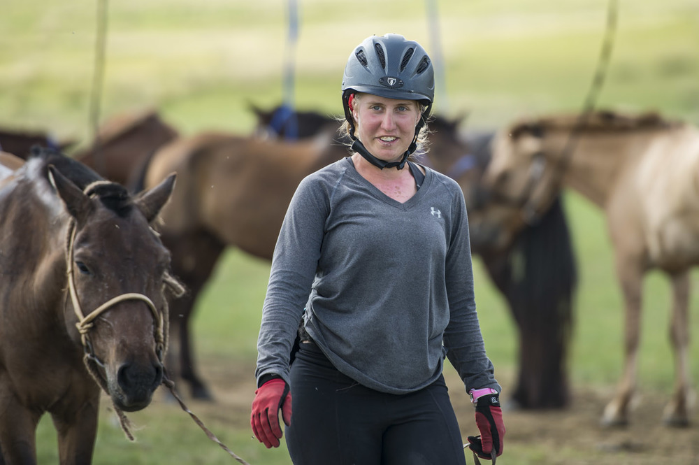 Devan Horn walks her horse around at horse station 24 on completing the leg, 10th Aug 2013