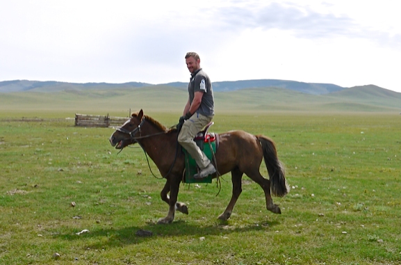 Prometheus Medic Chris riding a Mongolian horse