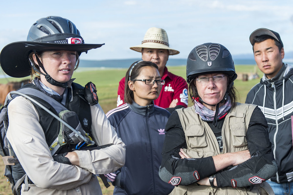 Katie Vincent (left) and Lynn Hamilton at a riders and crew briefing at horse station 9, 8th Aug 2013. Tsetsgee (2nd right), Bayarsaikhan and Shinesanaa are all Mongol Derby interpreters.