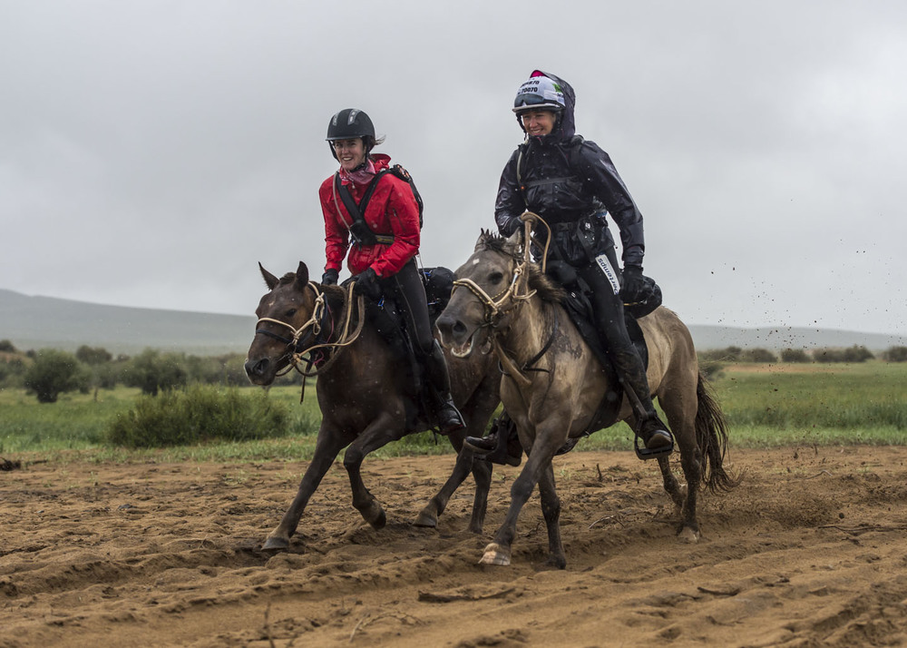 Chloe Phillips-Harris and Clare Twemlow ride into horse station 3 on Day 2, 5th Aug 2013