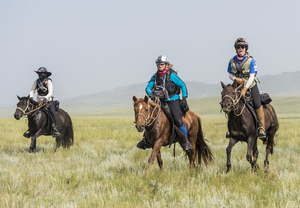 Left to right: Katie Vincent, Tamara Huddleston and Lydia Wood enjoy the first leg of the Mongol Derby, 4th August 2013