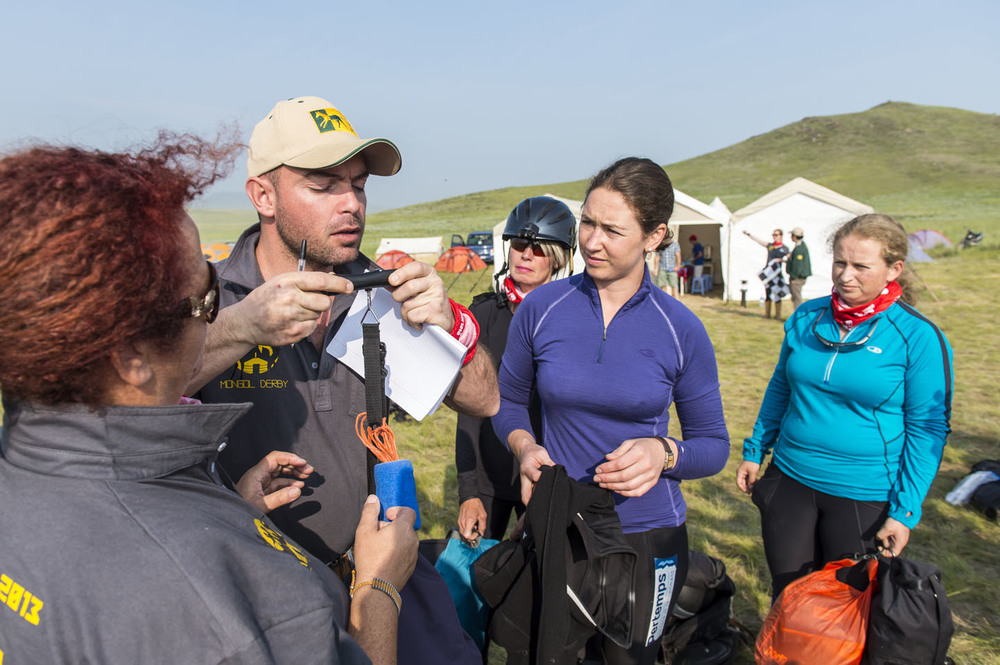 Charles Van Wyk weighs Clare Twemlow's gear, morning of the race 4th August 2013