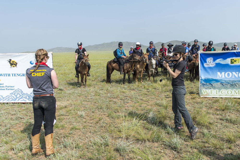 Mongol Derby Race Chief Katy Willings gives the riders a briefing at the start of the Mongol Derby, 4th August 2013. She was being filmed by the US news channel ABC
