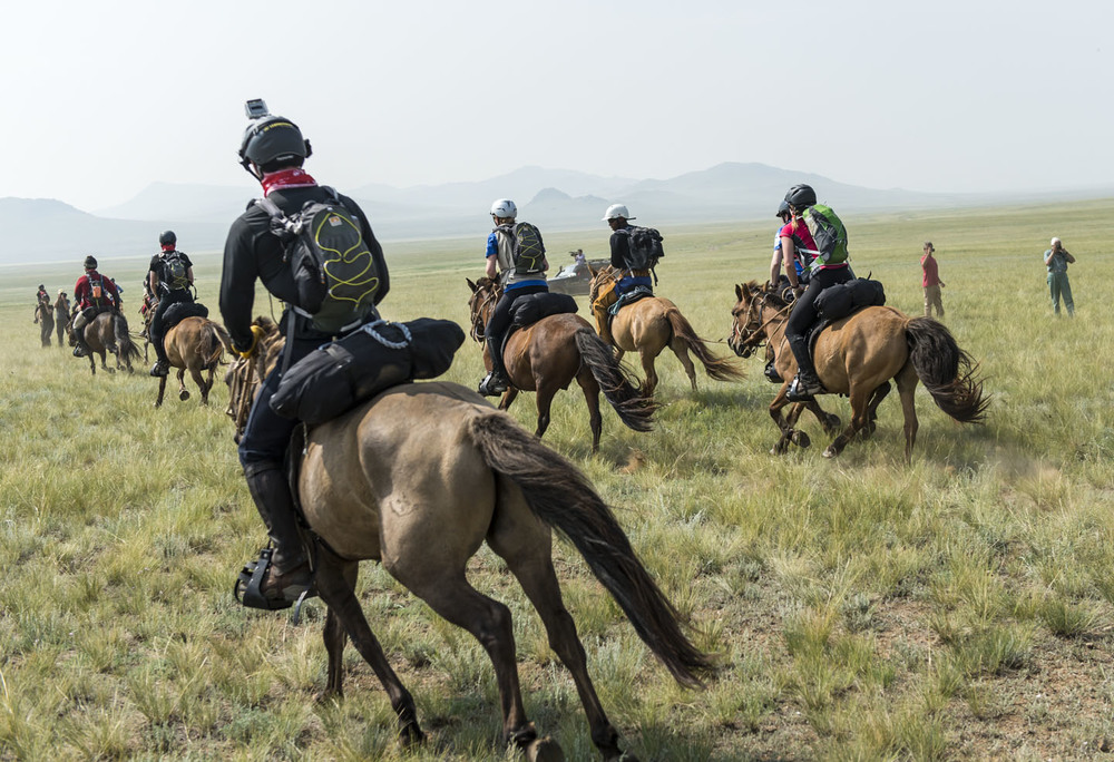 Runners stream away from the start of the Mongol Derby, 4th August 2013