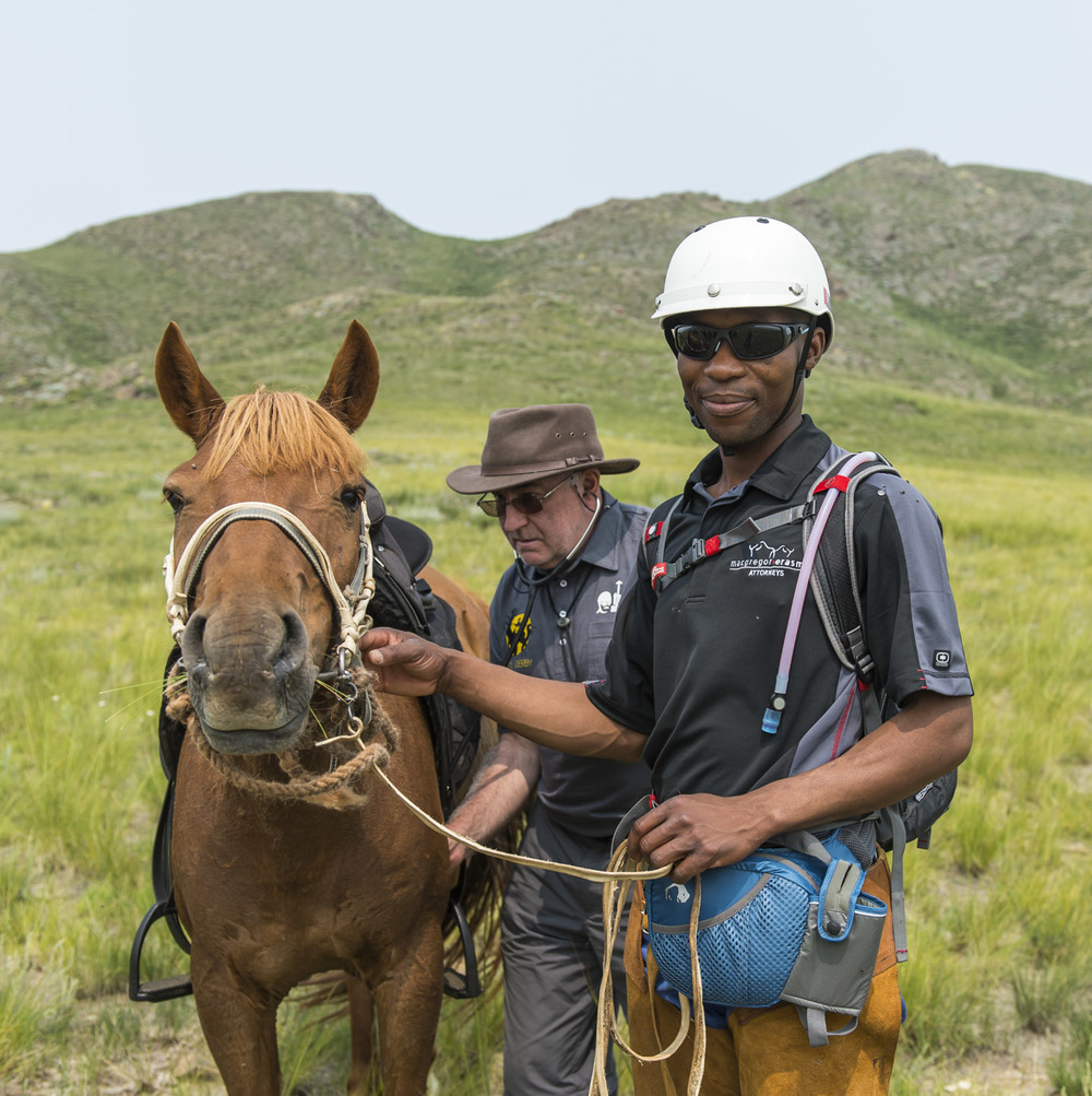 Chief Vet Harry McKerchar checks the heart rate of Mondi Kanyana's horse at the half way point of the training ride, 2nd August 2013