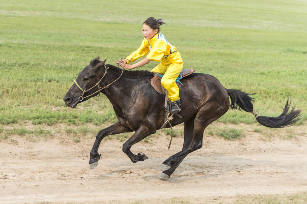 A young girl rider in the 12km horserace, 2nd August 2013