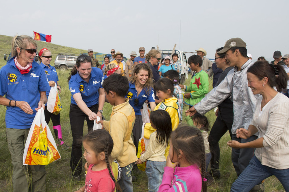 The Mongol Derby riders make a presentation of a goody bag to the local children, 2nd August 2013
