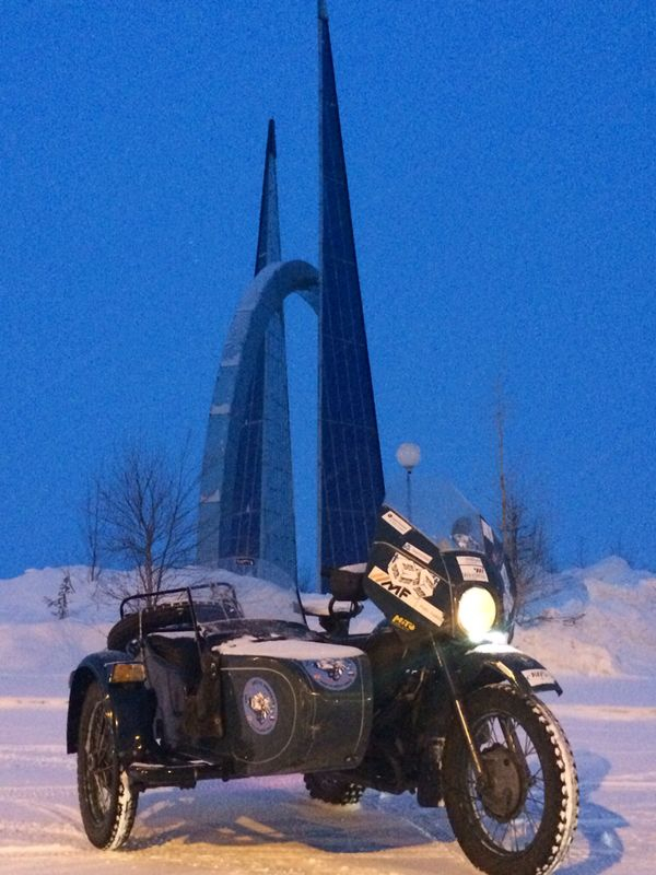 Karan's trusty steed aside the Arctic Circle monument