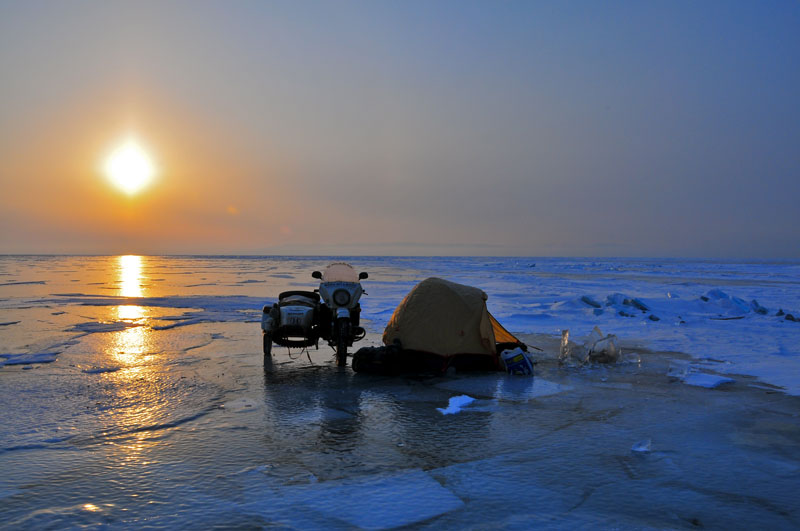 Camping solo with your trusty (ish) Ural on the expanse of Lake Baikal. With thanks to Hubert Kriegel for the image, www.thetimelessride.com.  Hubert did a mini Ice-Run way back in 2010 whilst riding his sidecar round the world