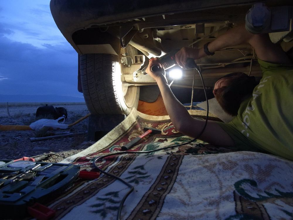 mongol rally soeren truemper repairing car week 7 cover shot.jpg