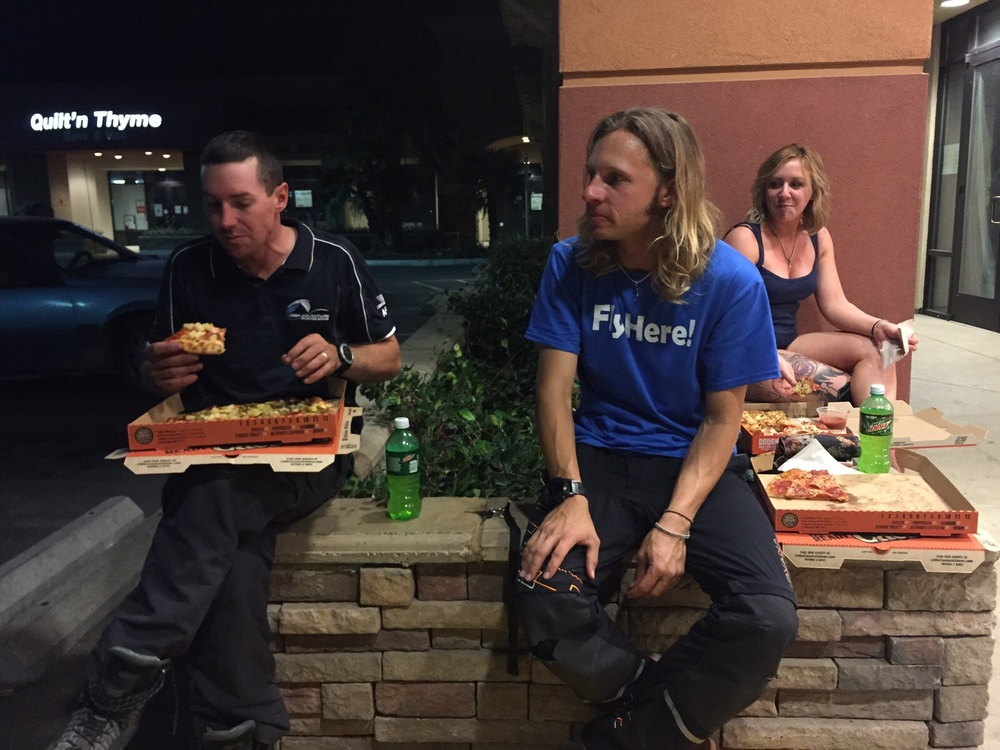 It's the end of the day, and our two frontrunners are enjoying some pizza.