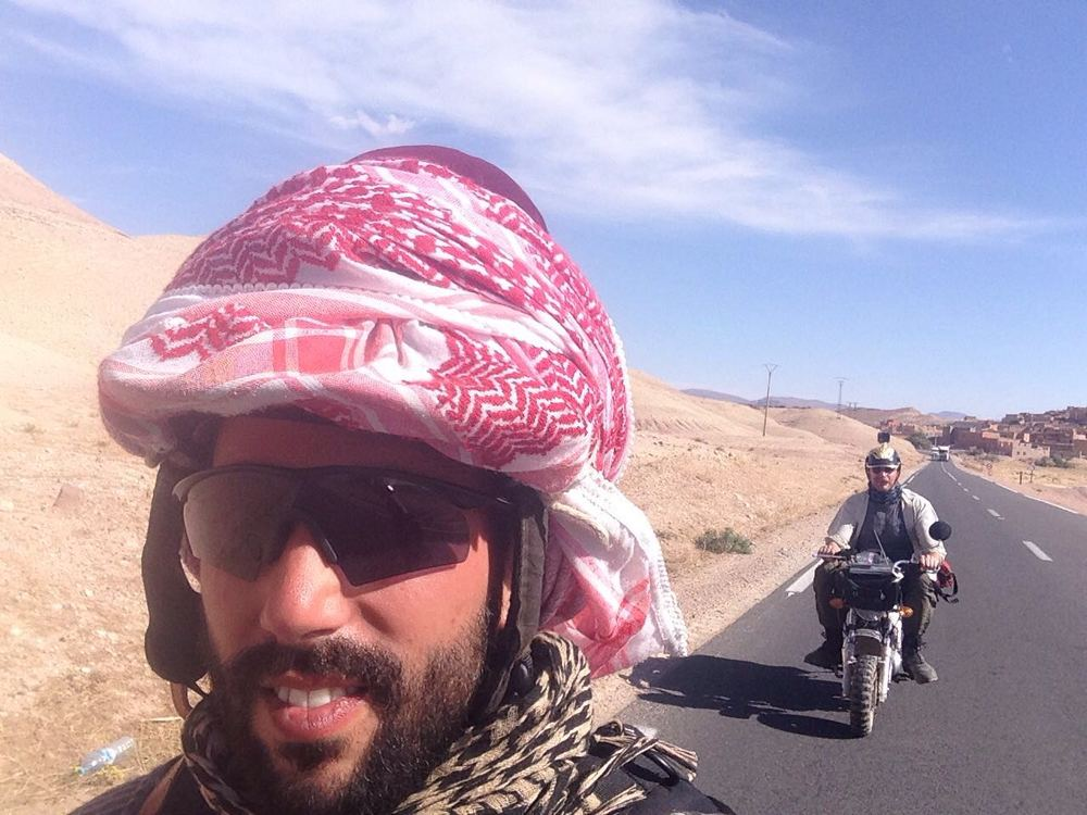 Jacopo taking an on-the-road selfie with Fred in the background