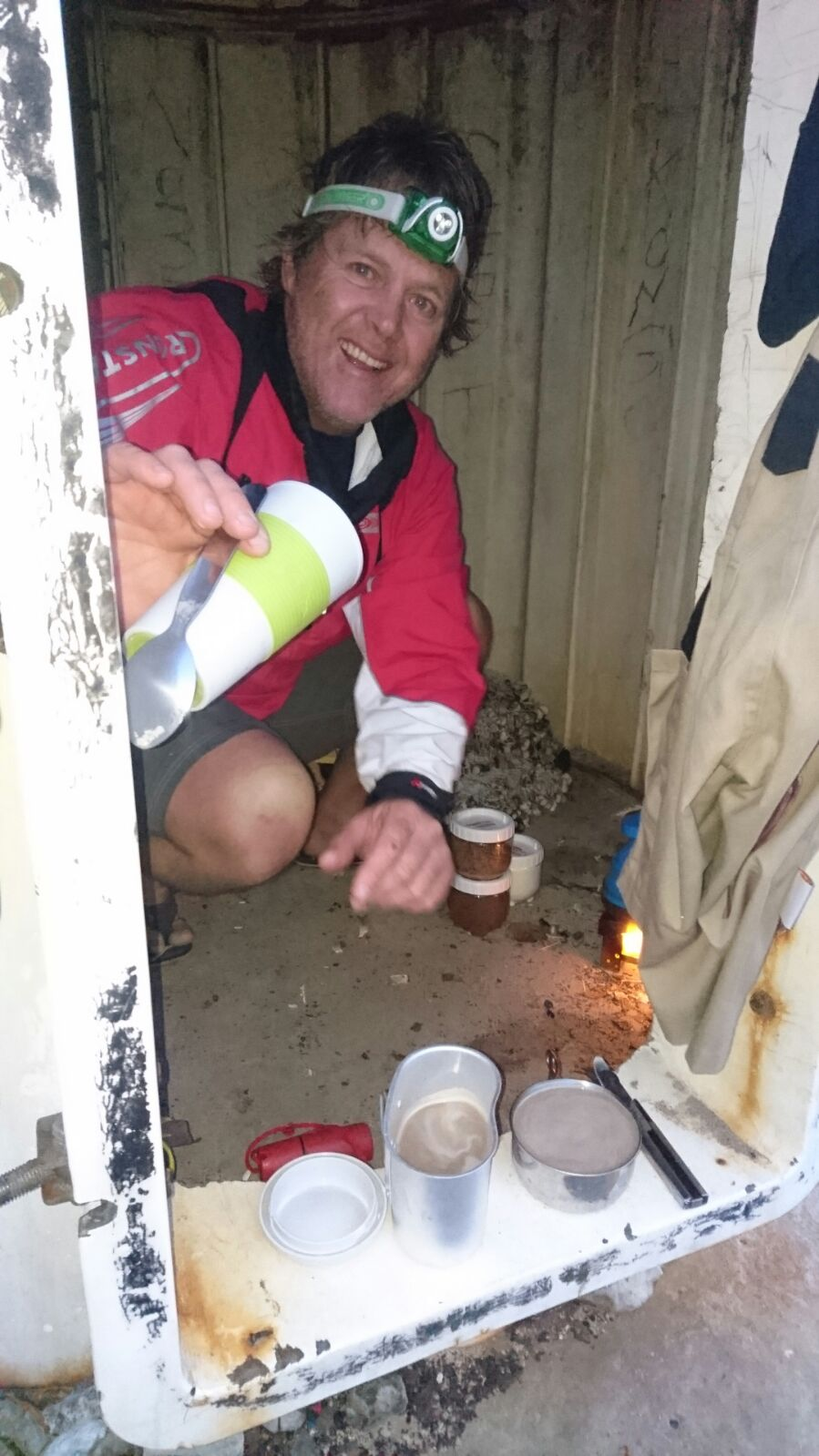 Mike makes coffee in the base of an abandoned light house.