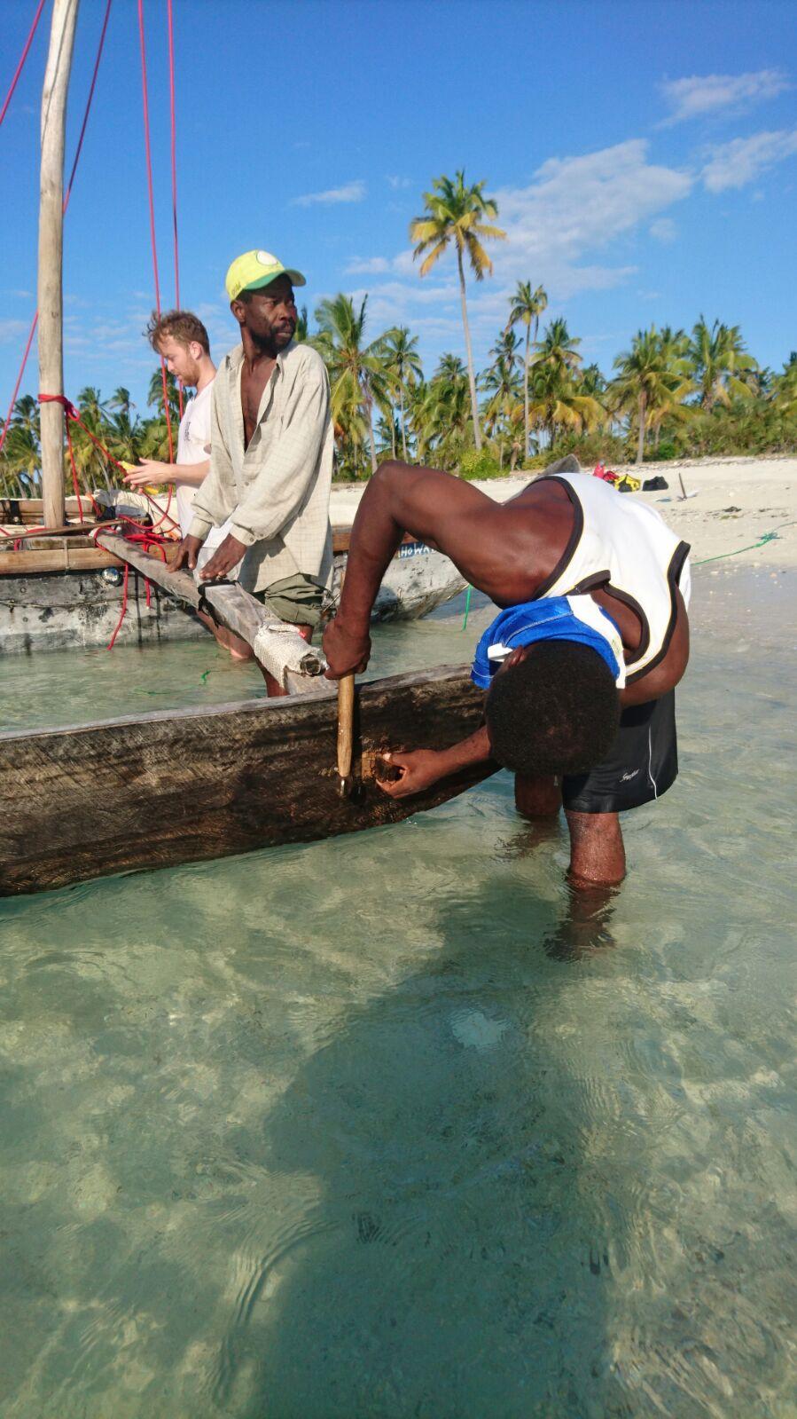 Boat repairs, men on hand