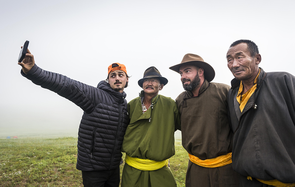 Race Managers Erik Cooper and Charles Van Wyk pose for a selfie with local herdsman at Urtuu 3