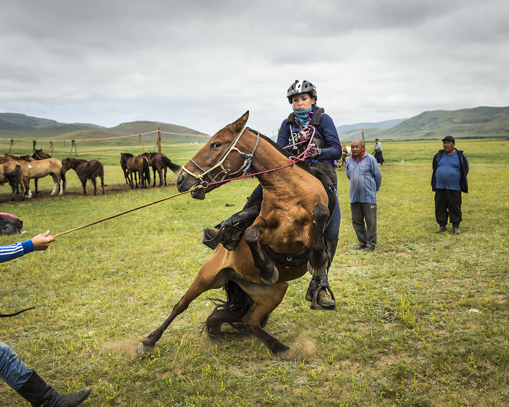 Marcia Hefker-Miles about to to hit the floor at Urtuu9. Both horse and rider were fine to continue Photo by Richard Dunwoody for Mongol Derby