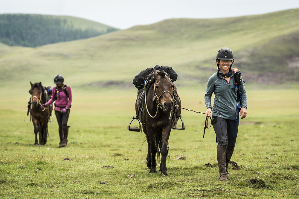 Alice Newling is all smiles walking into Urtuu16. Alexandra Hardham is following  Photo by Richard Dunwoody for Mongol Derby