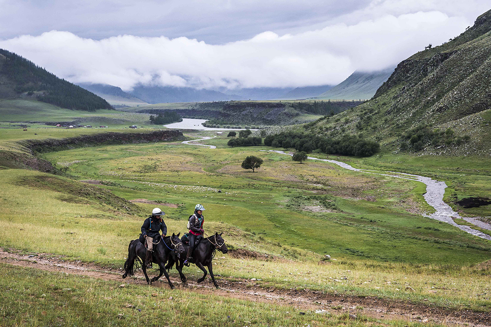 Willima Comiskey and Courtney Kizer ride together for a while on their way to Urtuu 19 passing another stunning valley