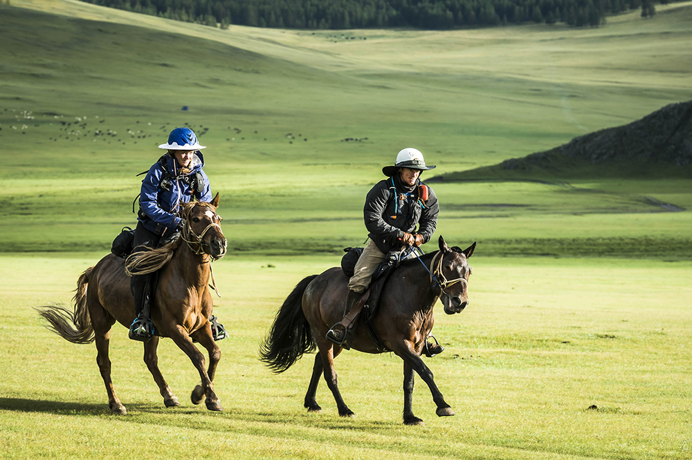 Heidi Telstad and William Comiskey gallop away from U22  Photo by Richard Dunwoody for Mongol Derby
