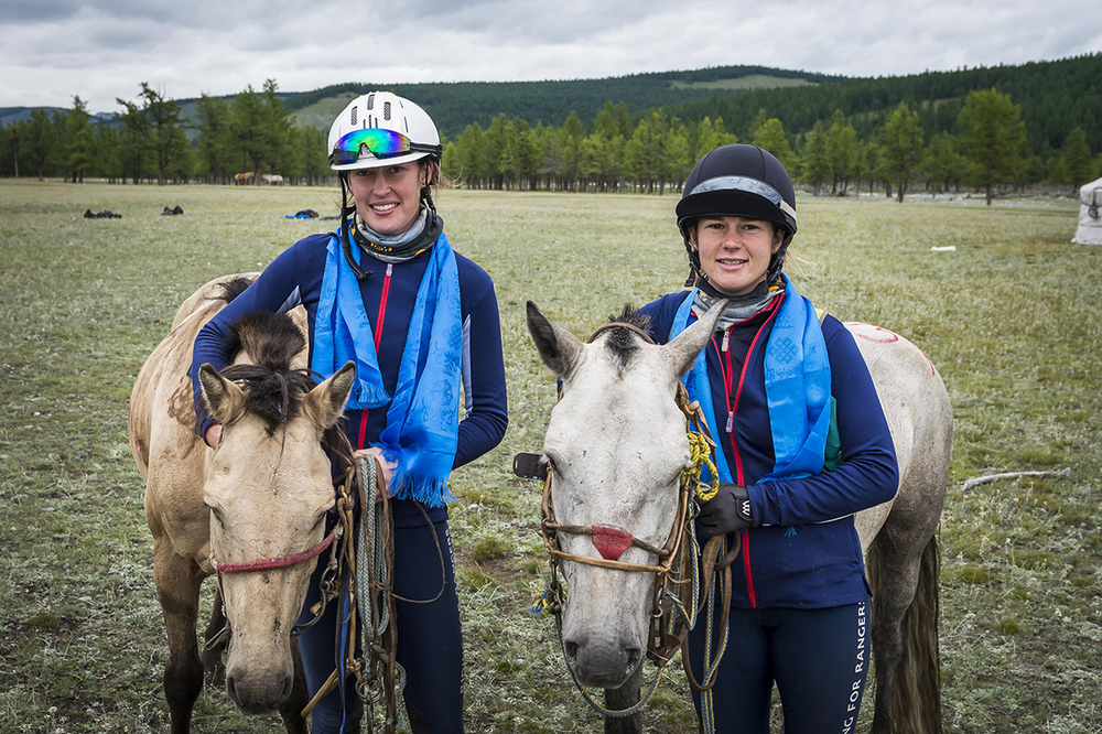Tatiana Mountbatten (sixth) and Venetia Philips (fouth) with their horses at the finish line Photo by Richard Dunwoody for Mongol Derby