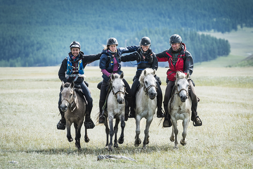David Redvers, right, comes over the finish line with Shannon Nott, Alexandra Hardham and Alice Newling Photo by Richard Dunwoody for Mongol Derby