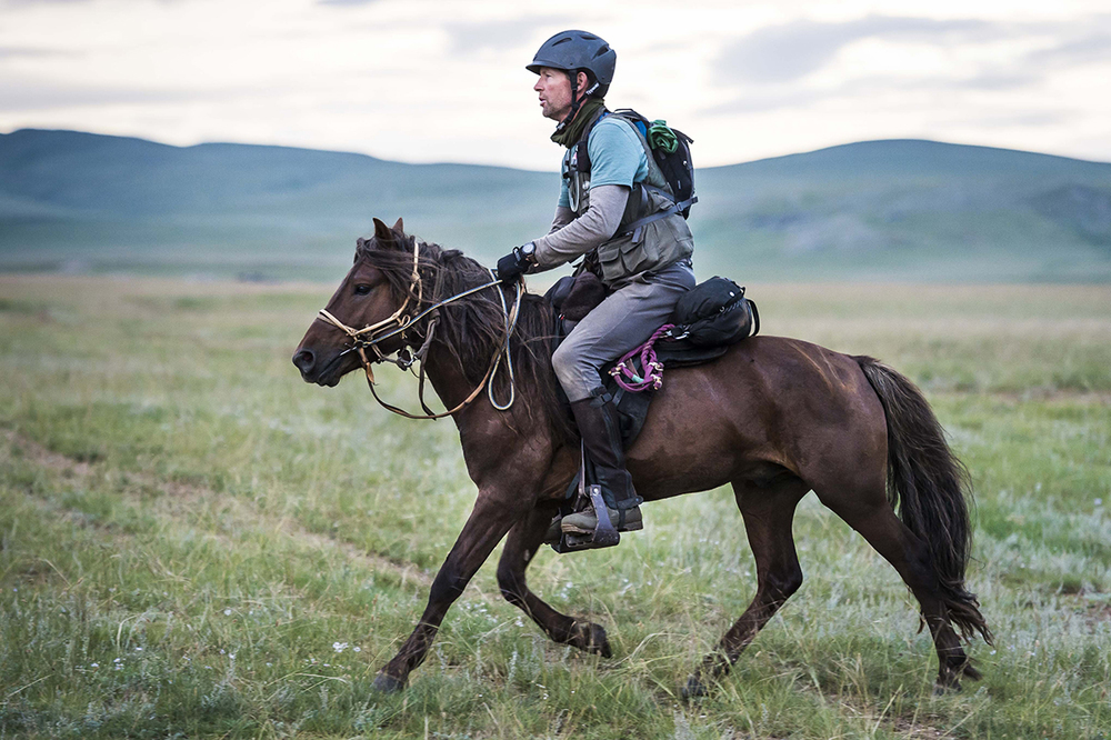 David Redvers leaves Urtuu 10 at daybreak, Day 4. Photo by Richard Dunwoody for Mongol Derby