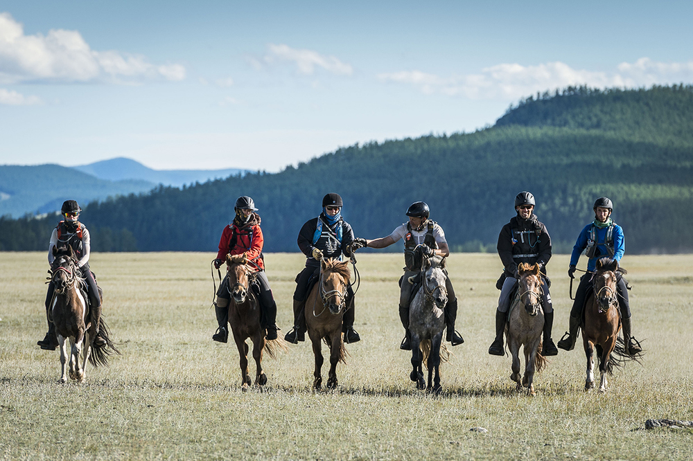 Rosie Bathurst, Marie Griffis, Kelly Hale Gareth, Jones, Francisco Schnaas and Pierce Buckingham ride in to the finish of the Mongol Derby 2016