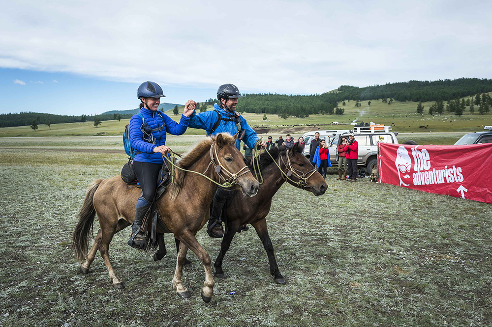 Camille Champagne Bargenquast with Peter Molony cross the line of the Mongol Derby 2016