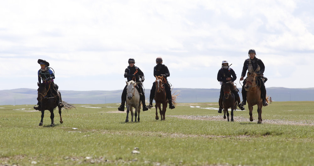 Riders leave at the start of The 2017 Mongol Derby on 9.8.2017. in Mongolia. Picture by: (C) Julian Herbert.