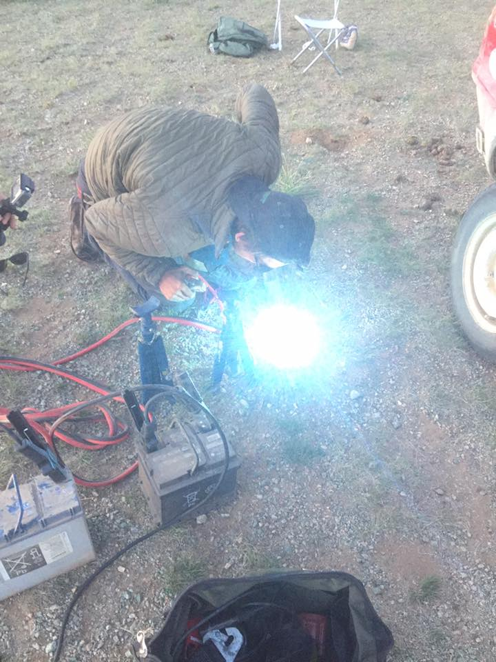 George Webb from Hijet Heroes welding up our exhaust with 2 car batteries and some wire we found in the steppe after it had fallen off 4 times, it is now still going strong after 1000kms! #madrallymoments #topbodge