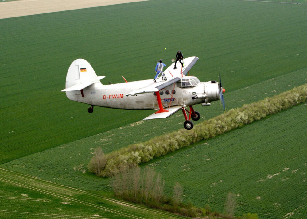 Here's me being stupid by playing tennis on the wing of a plane.