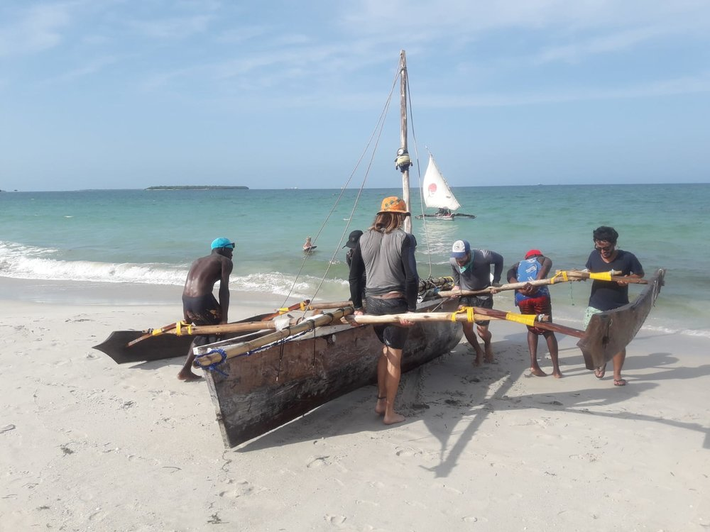 Team Eat Ship beaching their ngalawa to protect from the impending tide