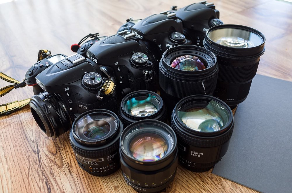All Nikons, all compatible, all comfortable, all badass to the bone (forgive the Sigma ART pollution there but there's a Voigtlander in front!)