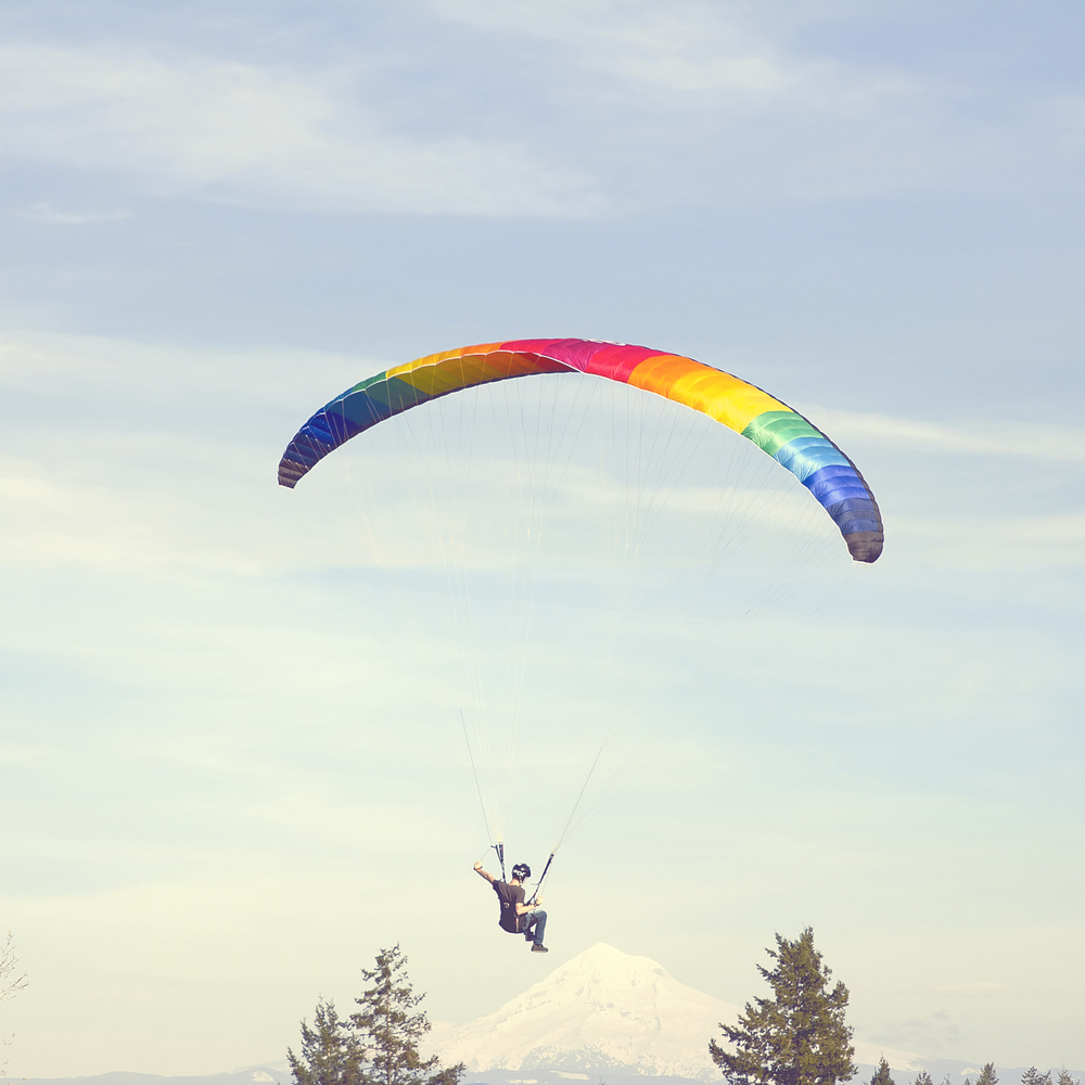 View of paraglider in Portland with Mt. Hood view.