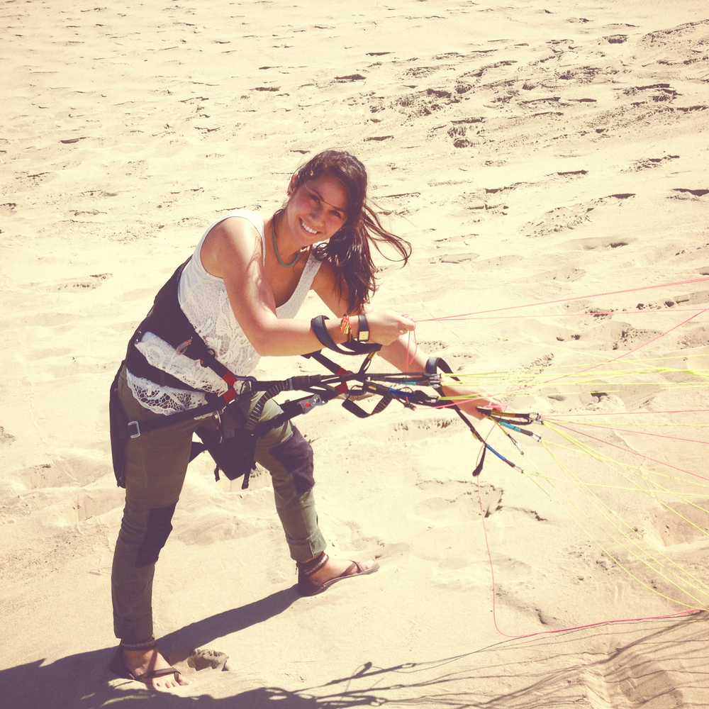 Girl learning how to paraglide on Oregon coast