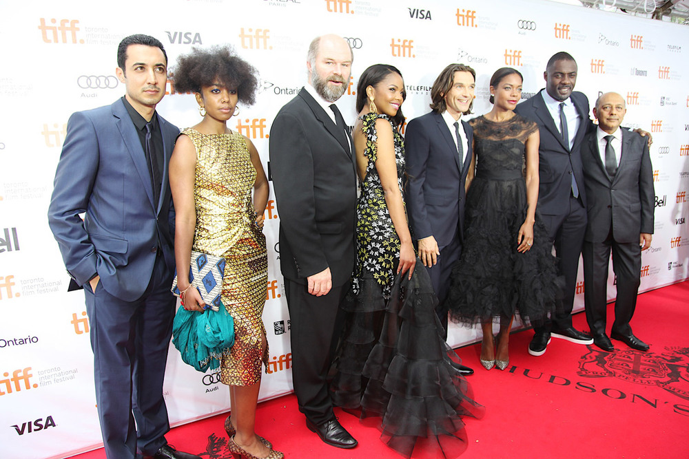 Riaad Moosa (Ahmed Kathrada), Lindiwe Matshikiza (Zindzi Mandela), Deon  Lotz (Kobie Coetsee), Terry Pheto (Evelyn Mase), director Justin  Chadwick, Naomie Harris (Winnie Madikizela Mandela), Idris Elba (Nelson  Mandela) and producer, Anant Singh. (Photo : Haidee Malkin - courtesy of  Videovision Entertainment)