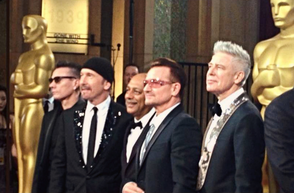 Anant Singh and U2 at the 86th Academy Awards
